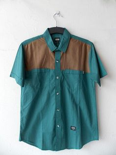 "Green brown ""OS.03.14.1002"" short shirt Olten, Rp175.000"