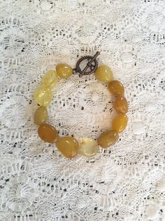 These beautiful citrine semi-precious Citrine gemstones are natural and come in various shapes, sizes, and shades of dazzling yellow. Strung on multiple strands of durable black bead weaving cord and fasted with a pretty rope designed copper colored, nickel-free toggle. Custom