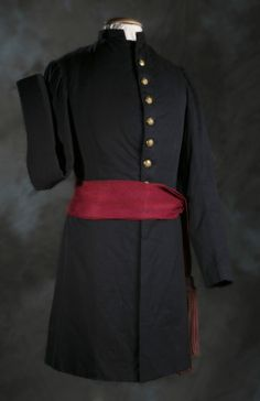 Uniform Coat and Sash of Captain Henry A. Kircher, 12th Missouri Infantry Volunteers. In 1863, at the battle of Ringgold Gap, Georgia, Kircher was seriously wounded, resulting in the amputation of his right arm and left leg. After his discharge Kircher returned to Belleville, Il and entered politics. A campaign photograph for circuit court clerk was circulated, showing the obvious sacrifices he had made while fighting for his country. He handily won the election. Missouri History Museum
