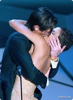 """Actor Adrien Brody suprises presenter Halle Berry with a kiss after he won the Oscar for Best a Actor for the """"The Pianist"""" at the 75th annual Academy Awards, March 2003, in Los Angeles"""