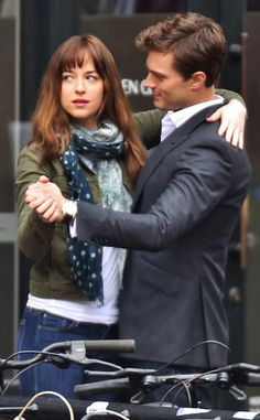 Fifty Shades of Grey Pics: Fun Fact: In Between Takes, Dakota Johnson and Jamie Dornan Danced To Keep Warm on Set :)   E! Online Mobile