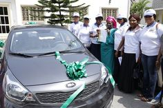 Chairman, COWLSO, Mrs. Bolanle Ambode (3rd left), supported by the 2016 COWLSO National Women's Conference Planning Committee, presenting a brand new saloon car to the 2nd runner-up of the 2016 NWC Raffle Draw, Alhaja Mopelola Ologolo (middle), at the Government House, Marina, at the weekend.