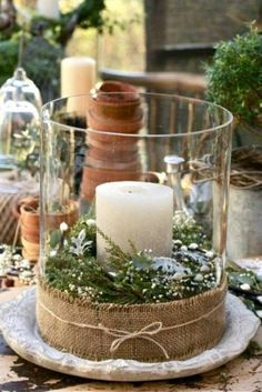 Escoge un jarrón transparente. Coloca en el fondo un mosi (espuma para clavar las flores y mantenerl... - Copyright © 2014 Hearst Magazines, S.L.
