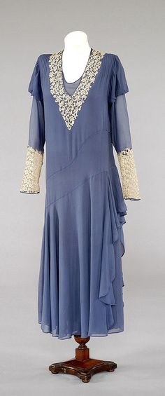 Wedding Dress  Wedding dress, deep power blue, silk crêpe, trimmed at neck and cuffs with cream guipure lace and self-fabric bias flounce on left side.    Place: England    Object Type: wedding dress    Period: George V    Actual Date: 1932
