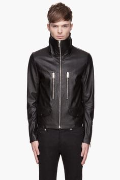 PAUL SMITH //  Black buffed leather raw-edged biker jacket  32260M032001  Long sleeve textured leather biker jacket in black. Spread collar. Zip closure, flap pockets, and zippered welt pockets at front. Raw edges at hem and sleeve cuffs. Welt pockets at interior. Fully lined. Tonal stitching. Zippered sleeve cuffs. Shell: 100% leather. Body lining: 100% cupro. Dry clean. Made in Italy.  $2495 CAD