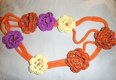 An i cord belt with crochet flowers http://www.shuval.biz http://www.zibbet.com/shuvalaccessories