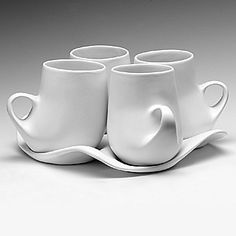 "Nice in white, too - Design I Mug Set (porcelain, white glaze)  five-piece set: four mugs (12oz) and tray  9""x9""x5"""