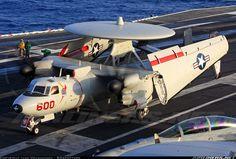 "Grumman E-2C Hawkeye 2000 (G-123) 164353 / AJ-600 (cn A-146) A Hawkeye from VAW-124 ""Bear Aces"" folds up after landing onboard the USS George HW Bush at sunset."