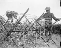 A complete 'knife-rest' barbed wire entanglement made by the 12th Battalion, Royal Scots, and ready to be placed in position, near Meteren, 25 June 1918. ©IWM (Q 6781)