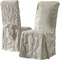 White side chairs to go with the blue cushion seat covers on all white distressed dining table.