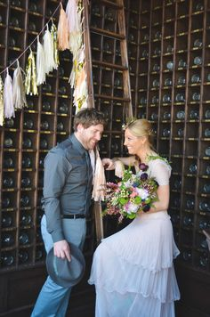 A Backdrop Of Beer Bottles Makes For Brewery Wedding Portraits Nicole Marie Photography