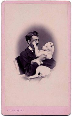 VINTAGE:  A man and his loving Pitbull puppy - quite a bond!  (From the Libby Hall Collection)