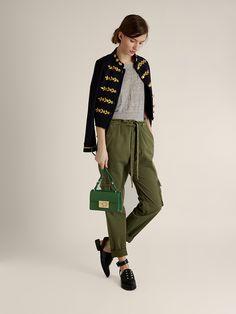 Matches.com military jacket, grey tee + cargo pants
