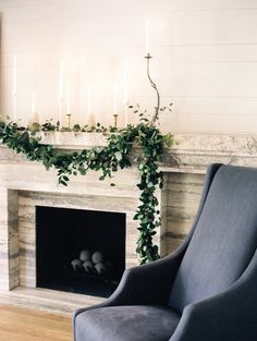 fireplace with marble mantle and eucalyptus garland  by Blush & Vine  Photography Dana Fernandez Photography