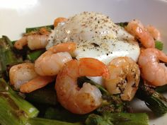 Roasted asparagus and shrimp topped with a poached egg