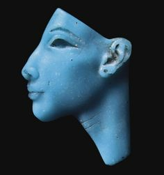 AN EGYPTIAN TURQUOISE GLASS FACE INLAY OF AKHENATEN OR NEFERTITI   NEW KINGDOM, DYNASTY XVIII, CIRCA 1353-1336 B.C.   The eye and eyebrow recessed for inlay, with enlarged pierced earlobe, the neck with two lightly incised 'vanity wrinkles'  1 11/16 in. (4.3 cm.) high