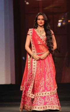 sunakshi seena in manish malhotra lehenga; different blouse cut, 3/4 mesh sleeves. Maybe a deeper red overall.