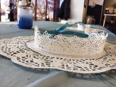 Tiaras made with ribbon backing to adjust to head size - We added Doily place mats and some sprayed mason jars to make a soft cinderella look!