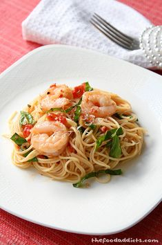 Succulent Shrimp Scampi - The Shrimp Scampi that we prepared is full of flavor from the butter, garlic, tomatoes, lemon, and basil tossed together with angel hair pasta and a whopping mound of shrimp.