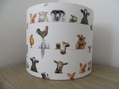A personal favourite from my Etsy shop https://www.etsy.com/uk/listing/246894458/sale-lampshade-drum-paper-shade-farm