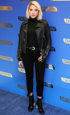 Ashley Benson in an All Saints leather jacket, Rag & Bone turtleneck, jeans and boots