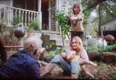 A walker almost gets to Lizzie and Judith, Mika shoots him.