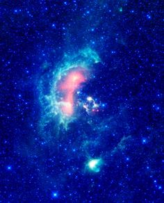 An infrared image from NASA's WISE, showcases the #Tadpolenebula, a star-forming hub in the Auriga constellation about 12,000 light-years from Earth. (Photo by: Universal History Archive/UIG via Getty Images)
