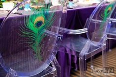 Peacock feather decal on a ghost chair. www.reflectionsweddings.ca