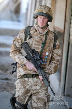 Prince Harry patrols the deserted town of Garmisir close to FOB Delhi (forward operating base) while posted in Helmand Province in Southern Afghanistan