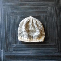 a soft, simple gender neutral newborn hat. made with 100% wool. pictured in newborn size. if you are unsure if this hat would fit your child