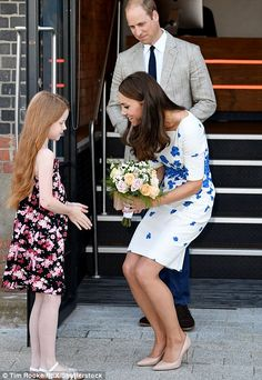 8/24/16*Prince William looked lovingly at his wife as she chatted to the youngster