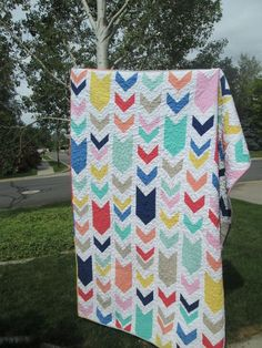 Chevron Quilt Coral Mint Navy Yellow Blue by quackadoodlequilt, $80.00  **for miles.. grey background with black, brown and green chevrons.. maybe only two or three rows of chevrons. integrate patch collection** by ellen