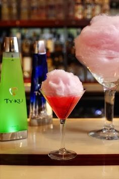 Cotton Candy Martini-Raspberry Vodka, Chambord, Grenadine, Champagne, and Topped with Cotton Candy!