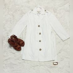Michael Kors Trench Coat Cute white MK trench coat with matching belt! Rarely worn. Michael Kors written on the buttons. Super cute! No rips, stains, or tears. Comment if you have questions! ❌Trades Bundle and SAVE! Happy Poshing☺️ Michael Kors Jackets & Coats Trench Coats