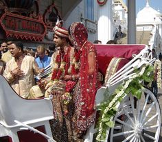 Indian/South Asian wedding Vidai horse and carriage on boardwalk Atlantic City Trump Taj. The Vidai is when the newly married couple leaves the wedding celebration. The bride had diamonds sewn into her dress.
