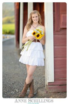 Senior Portraits by Anne Schillings Photography Sonoma County portrait artist aqua dress necklace floral belt bracelet teal blue green turquoise lavender flowers vineyard summer purple gown dress prom girl high school high heels pose model garden wine country winery field smile laugh girl woman jeans tank top beautiful pretty butterfly barn sunflower yellow red boots sunset https://www.facebook.com/anneschillingsphotography?ref=hl