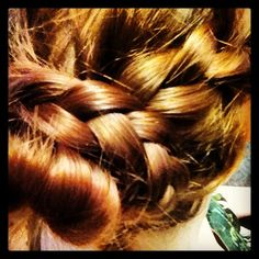 Fun and easy messy-princess braided bun!  1. Separate hair in three layers from the top of your head down. 2. Make a bun out of the top layer as high as possible on the head (how tight is up to you!)  3. Braid the mid-section to one side and wrap it around the bun, pinning it under the bun with a bobby pin or the like. 4. Braid the bottom layer on the opposite side and wrap it around the bun again, again pinning it underneath. 5. Feel fancy!