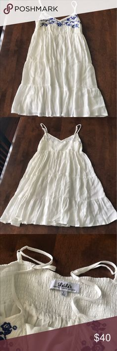 White flowered spaghetti strap dress Adorable white/cream tank dress from lulu's boutique! Accented with dark blue flowers. Would be perfect for a summer wedding, nice dinner or any semi-formal event! Double layered for extra protection! Great quality, 100% rayon. Lulu's Dresses