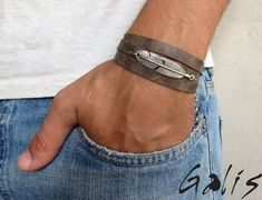 "Men's Bracelet - Men's Feather Bracelet - Mens Gray Bracelet - Men's Leather Bracelet - Men's Jewelry - Bracelets For Men - Jewelry For Men  Looking for a gift for your man? You've found the perfect item for this!   The simple and beautiful warp bracelet combines gray leather texture and a silver plated feather pendant.   The bracelet clasp is easy to use and safe.   Bracelet Length: 22.8 (53 cm) + 2"" (5 cm) extension chain.  $34"