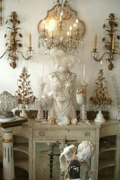 Pearl beading on this vintage style dress form. Lots of crystal and shabby chic white antique furniture. Glam with an at home style