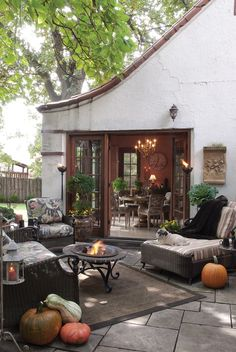 Cozy terrace in country style with soft garden furniture, lights and torches.