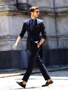 Gentleman style trailered suit and euro cut pant....love the sock free casual touch