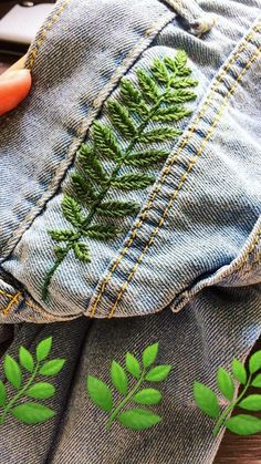 Fern leaf embroidered into denim
