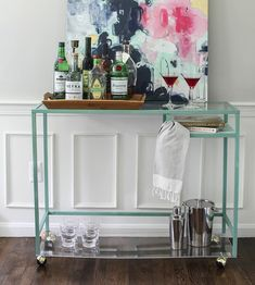 Using an Ikea laptop table and an acrylic sheet, this bar cart tutorial made a very standard piece perfect for entertaining.