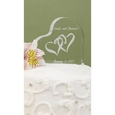 Acrylic cake top with entwined hearts design.