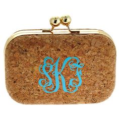 Make a night on the town even more special with this cool and clever monogrammed cork clutch with removable chain. A perfect bag for bridesmaids.