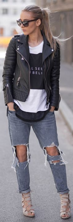 Sendi Skopljak is wearing a leather jacket from Boda, black and white long sleeved T-shirt from Rut & Circle, jeans from Chicy and the tan shoes are from Aldo