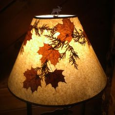 Great Adirondack style lamp shade with maple and cedar leaves.