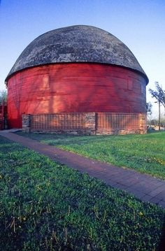 """Round Barn in Arcadia,Oklahoma. Built in 1898. After 90 years the roof collapsed in 1988. A retired contractor from Oklahoma City and some volunteers named the """"over the hill gang"""" who were mostly over 65 years of age, restored to old barn. It is the only wooden round barn in Oklahoma."""