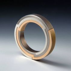 Swiss ring by Daniel Chiquet.  The ring can be decomposed into its three components. | Gold, silver, titanium